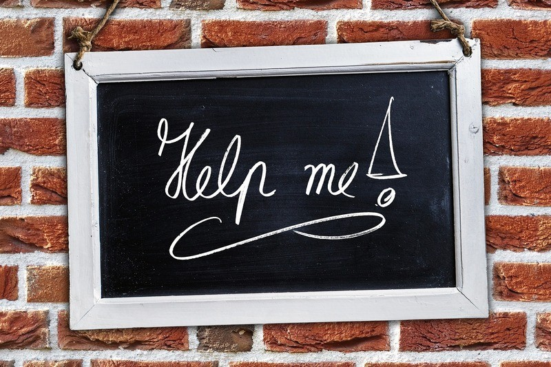 The sign with the text 'Help me!'